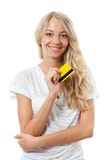 Blonde woman holding yellow credit card Royalty Free Stock Photos