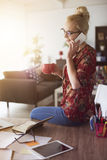 Blonde woman in home office Royalty Free Stock Image