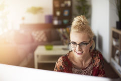 Blonde woman in home office Stock Images