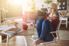 Blonde woman in home office Royalty Free Stock Images