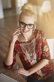 Blonde woman in home office Royalty Free Stock Photo