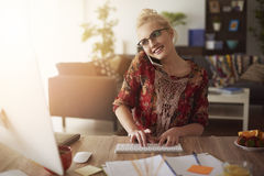 Blonde woman in home office Stock Photo