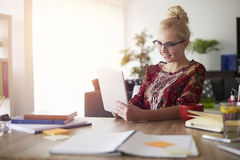 Blonde woman in home office Royalty Free Stock Photos