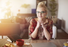 Blonde woman in home office Stock Photography