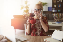 Blonde woman in home office Stock Photos