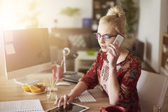 Blonde woman in home office Royalty Free Stock Photography