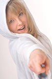 Blonde Woman In Hooded  White Bathrobe. Beautiful Blonde Woman With Blue Eyes In Bathrobe Pointing With Finger Royalty Free Stock Images