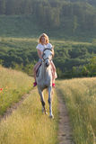 Blonde woman and horse Royalty Free Stock Photography