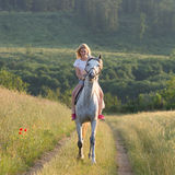 Blonde woman and horse Stock Photos