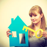 Blonde woman with house and key. Royalty Free Stock Photo