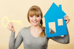 Blonde woman with house and key. Royalty Free Stock Photography