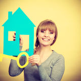 Blonde woman with house and key. Stock Photos