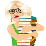 Blonde woman hugging stack of books happily Stock Image