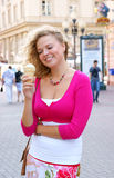 Blonde woman with ice cream Royalty Free Stock Photography