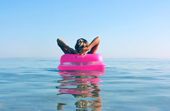 Blonde woman with inflatable raft Royalty Free Stock Photos