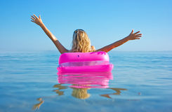 Blonde woman with inflatable raft Stock Photo