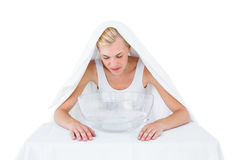 Blonde woman inhaling herbal medicine Stock Photo