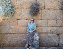 Blonde woman inside the ruins of knidos Royalty Free Stock Photo