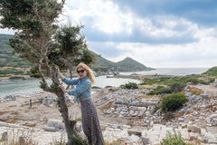 Blonde woman inside the ruins of knidos Stock Images