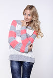 Blonde woman  in jeans and sweater Stock Images