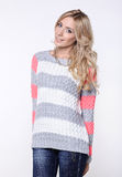Blonde woman  in jeans and sweater Royalty Free Stock Images