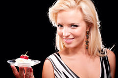 Blonde woman with juicy strawberry Royalty Free Stock Images