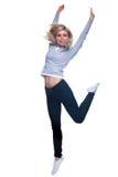 Blonde woman jumping Stock Photos