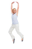 Blonde woman jumping like a ballerina Royalty Free Stock Photo