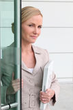 Blonde woman with a laptop Stock Photography