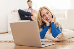 Blonde woman with laptop Stock Images