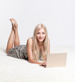 Blonde woman with laptop Royalty Free Stock Photos