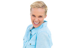 Blonde woman laughing at camera Stock Image