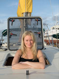 Blonde woman learing to sail in Croatia. Learning to sail on the Adriatic Stock Photo
