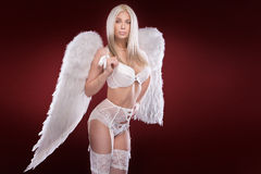 Blonde woman like an angel. Royalty Free Stock Photos