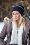 Blonde woman linstening music outdoor at winter Royalty Free Stock Images