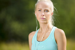 Blonde woman listen to music when she exercise Stock Photo