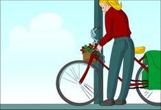 Blonde woman locking bike post Stock Photo