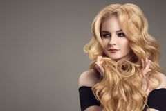 Blonde woman with curly beautiful hair. Blonde woman with long curly beautiful hair stock image