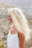 Blonde woman with long hair Stock Images