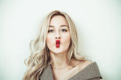 Blonde woman making face expressions stock photos