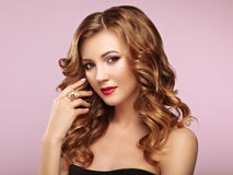 Blonde woman with long shiny wavy hair Stock Photo