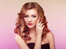 Blonde woman with long shiny wavy hair Stock Photography