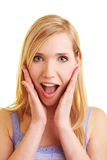 Blonde woman looking excited Royalty Free Stock Image