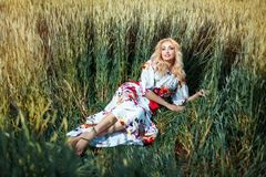 Blonde woman lying in a field. Stock Images