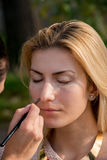 Blonde woman during a make-up session. Blonde young woman during a make-up session Stock Photography