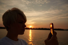 Blonde woman makes selfy Stock Image