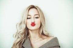 Blonde woman making face expressions royalty free stock image