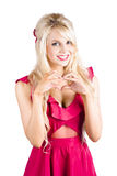 Blonde woman making heart shape Royalty Free Stock Photos