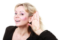 Blonde woman making listening gesture Royalty Free Stock Photo
