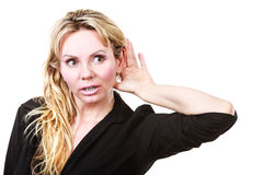 Blonde woman making listening gesture Stock Images
